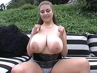 Paunchy busty mom shared by two guys outdoor