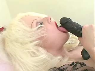 Fat blonde with pierced cunt plays with big dildo
